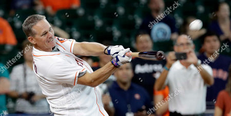 Stock Image of Houston Astros Hall of Fame second baseman Craig Biggio competes in a legends weekend home run derby, in Houston. Luke Scott won the event