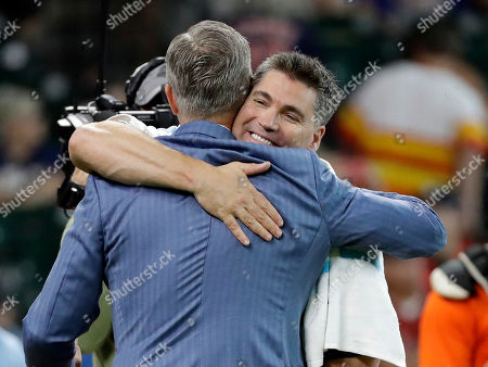 Former Houston Astros outfielder Luke Scott, right, is hugged by team president of business operations Reid Ryan after winning the legends home run derby, in Houston