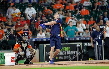 Former Houston Astros outfielder Luke Scott competes in a legends weekend home run derby, in Houston. Scott won the event