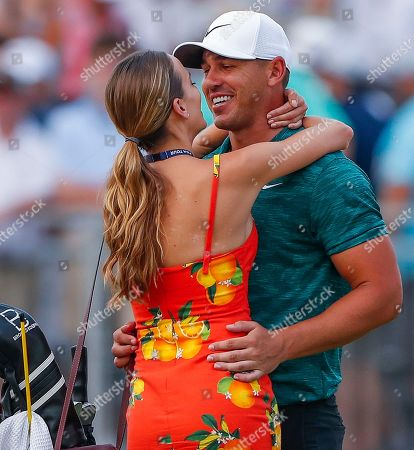 Brooks Koepka (R) of the US kisses his girlfriend Jena Sims (L) after winning the 100th PGA Championship golf tournament at Bellerive Country Club in St. Louis, Missouri, USA, 12 August 2018.