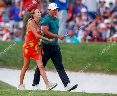 Brooks Koepka (R) of the US with his girlfriend Jena Sims (L) walk after winning the 100th PGA Championship golf tournament at Bellerive Country Club in St. Louis, Missouri, USA, 12 August 2018.