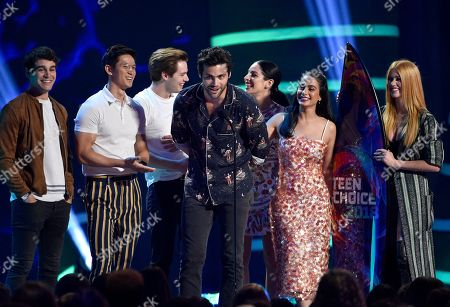 "Alberto Rosende, Harry Shum Jr., Dominic Sherwood, Matthew Daddario, Anna Hopkins, Emeraude Toubia, Katherine McNamara. Alberto Rosende, from left, Harry Shum Jr., Dominic Sherwood, Matthew Daddario, Anna Hopkins, Emeraude Toubia and Katherine McNamara accept award for choice sci-fi/fantasy TV show for ""Shadowhunters: The Mortal Instruments"" at the Teen Choice Awards at The Forum, in Inglewood, Calif"