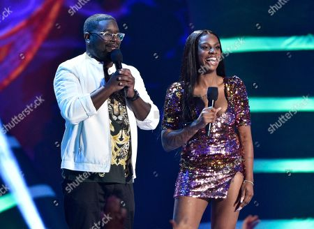 Lil Rel Howery, Jess Hilarious. Lil Rel Howery, left, and Jess Hilarious speak on stage at the Teen Choice Awards at The Forum, in Inglewood, Calif