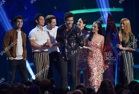 "Alberto Rosende, Harry Shum Jr., Dominic Sherwood, Matthew Daddario, Anna Hopkins, Emeraude Toubia, Katherine McNamara. Alberto Rosende, from left, Harry Shum Jr., Dominic Sherwood, Matthew Daddario, Anna Hopkins, Emeraude Toubia, and Katherine McNamara accept award for choice sci-fi/fantasy tv show for ""Shadowhunters: The Mortal Instruments"" at the Teen Choice Awards at The Forum, in Inglewood, Calif"