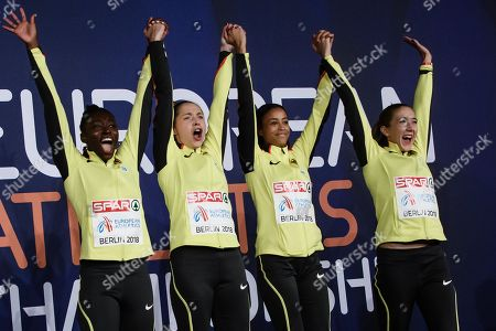Lisa Marie Kwayie (L), Gina Lueckenkemper (2-L), Tatjana Pinto (2-R) and Rebecca Haase (R) of Germany hold hands during the award ceremony of the women's 4x100m Relay at the Athletics 2018 European Championships in Berlin, Germany, 13 August 2018.