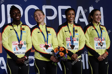 Lisa Marie Kwayie (L), Gina Lueckenkemper (2-L), Tatjana Pinto (2-R) and Rebecca Haase (R) of Germany attend the award ceremony of the women's 4x100m Relay at the Athletics 2018 European Championships in Berlin, Germany, 13 August 2018.