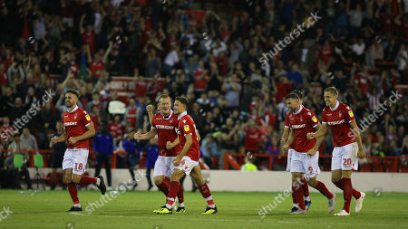 The Forest players celebrate after Luke Steele saves the decisive penalty during sudden death