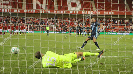 Luke Steele saves the final penalty of the night as Forest advance