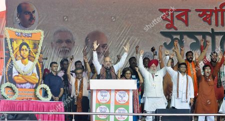 BJP National President, Amit Shah, BJP youth leader Poonam Mahajan, Minister Babul Supriyo, West Bengal BJP Chief Dilip Ghosh, leader Mukul Roy with other party leaders during a public rally on August 11, 2018 in Kolkata, India. BJP president Amit Shah kick-started his party's political campaign in West Bengal against TMC chief Mamata Banerjee ahead of the 2019 Lok Sabha polls. This is the first rally of the BJP president in the state and comes in the backdrop of protest by TMC and Congress workers.