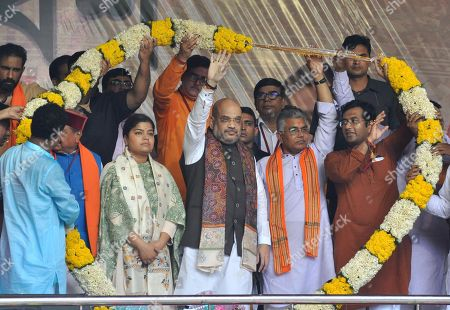 BJP National President, Amit Shah, BJP Yuva Morcha leader Poonam Mahajan, Minister Babul Supriyo, West Bengal BJP Chief Dilip Ghosh, leader Mukul Roy with others during party President Amit Shah's rally on August 11, 2018 in Kolkata, India. BJP president Amit Shah kick-started his party's political campaign in West Bengal against TMC chief Mamata Banerjee ahead of the 2019 Lok Sabha polls. This is the first rally of the BJP president in the state and comes in the backdrop of protest by TMC and Congress workers.