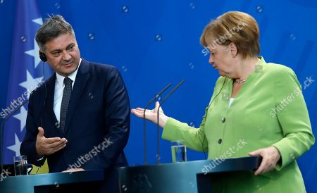 The German Chancellor Angela Merkel (R) and President of the Council of Ministers of Bosnia and Herzegovina Denis Zvizdic gestures during their joint press conference following their meeting at the Chancellery in Berlin, Germany, 13 August 2018. Both leaders discussed the bilateral relations of their countries during their meeting.