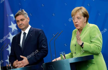 The German Chancellor Angela Merkel (R) and President of the Council of Ministers of Bosnia and Herzegovina Denis Zvizdic during their joint press conference following their meeting at the Chancellery in Berlin, Germany, 13 August 2018. Both leaders discussed the bilateral relations of their countries during their meeting.