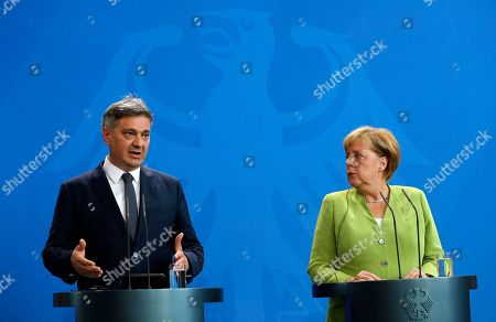 The German Chancellor Angela Merkel (R) listens to President of the Council of Ministers of Bosnia and Herzegovina Denis Zvizdic during their joint press conference following their meeting at the Chancellery in Berlin, Germany, 13 August 2018. Both leaders discussed the bilateral relations of their countries during their meeting.