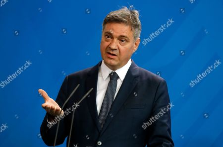 The President of the Council of Ministers of Bosnia and Herzegovina Denis Zvizdic speaks next to German Chancellor Angela Merkel (not pictured) during a joint press conference following their meeting at the Chancellery in Berlin, Germany, 13 August 2018. Both leaders discussed the bilateral relations of their countries during their meeting.
