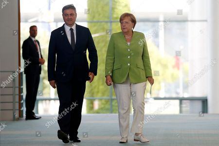 President of the Council of Ministers of Bosnia and Herzegovina Denis Zvizdic and German Chancellor Angela Merkel arrive for a joint press conference following their meeting at the Chancellery in Berlin, Germany, 13 August 2018. Both leaders discussed the bilateral relations of their countries during their meeting.