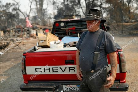 Ed Bledsoe cries after searching through what remains of his home, in Redding, Calif. Bledsoe's wife, Melody, great-grandson James Roberts and great-granddaughter Emily Roberts were killed at the home in the Carr Fire