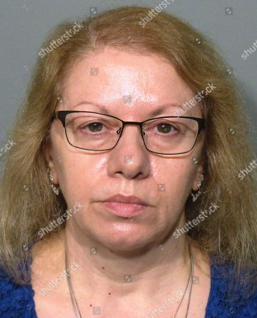This booking photo released, by the New Canaan Police Department shows Joanne Pascarelli, of Stratford, Conn., a former cafeteria worker who along with her sister Marie Wilson was charged with stealing nearly a half-million dollars from New Canaan, Conn., schools over the last five years