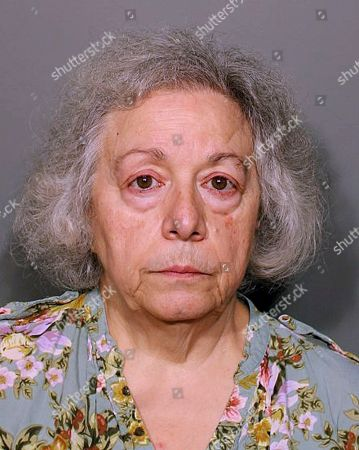 This booking photo released, by the New Canaan Police Department shows Marie Wilson, of Wilton, Conn., a former cafeteria worker who along with her sister Joanne Pascarelli was charged with stealing nearly a half-million dollars from New Canaan, Conn., schools over the last five years