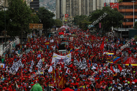 Supporters of the ruling party participate in a march in support of President Nicolas Maduro, in Caracas, Venezuela, 13 August 2018. Thousands of Chavistas marched in Caracas to denounce the 04 August attack on Venezuelan President Nicolas Maduro, who blamed it on deputies Juan Requesens, Julio Borges and former Colombian President Juan Manuel Santos.