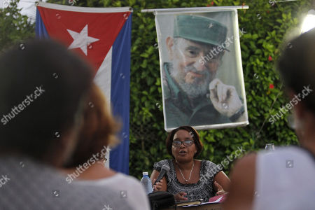 Ivet Almeida (C), member of the municipal bureau of the Communist Party of Cuba (PCC), presides over a Discussion Assembly, in a neighborhood in Havana, Cuba, 13 August 2018. Among tributes to the deceased former President Fidel Castro on his posthumous birthday, Cuba opened the process of popular consultation of its new Constitution with the first meetings of citizens who for three months will propose changes in the text, which was preliminarily approved by Parliament.