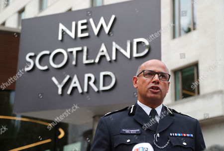 Assistant Commissioner Neil Basu speaks to the media outside New Scotland Yard in London,. Authorities said in a statement Tuesday that a man in his 20s was arrested on suspicion of terrorist offenses after a silver Ford Fiesta collided with a number of cyclists and pedestrians before crashing into the barriers during the morning rush hour