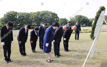 South Korean President Moon Jae-in (C) and his wife Kim Jung-sook pay tribute during a ceremony to mark the International Day for the Victims of the Japanese Military's Sexual Slavery at a comfort women's cemetery in Cheonan, South Chungcheong Province, on 14 August 2018, the International Day for the Victims of the Japanese Military's Sexual Slavery and one day ahead of the 73rd anniversary of National Independence Day. Lee is one of some 200,000 Asian women, mostly Koreans, who were forcibly taken to front-line military brothels by Japan during World War II. They are euphemistically called comfort women.