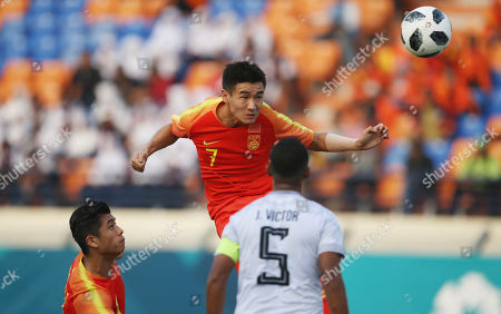 China's Wei Shihao, center, heads a ball during their soccer match between China and East Timor at the 18th Asian Games at Si Jalak Harupat Stadium in Bandung, Indonesia