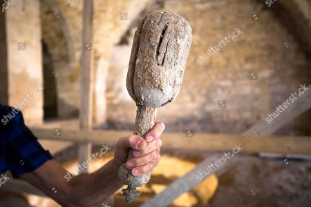 An Israeli employee of Uri Geller Museum show a hummer found at a 'Masbena' in Arabic or a soap manufacturing factory from olive oil dated to the 19th Century from the Ottoman Empire period, in the Old City of Jaffa, outskirts of the Israeli coastal city of Tel Aviv, 14 August 2018. According to the Israel Antiquities Authority Jaffa expert, this previously unknown factory, is the second of its kind to have been discovered in Jaffa. The site was well preserved and included troughs for mixing raw materials for the soap, a large cauldron, a hearth, water cisterns and underground vaults that were used for storage. The production of soap from olive oil was sold locally, while a large share was destined for export to regions within the Ottoman Empire, mainly for the Egyptian market.