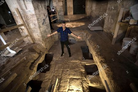 Uri Geller owner of Uri Geller Museum and an stands at a 'Masbena' in Arabic or a soap manufacturing factory from olive oil dated to the 19th Century from the Ottoman Empire period, in the Old City of Jaffa, outskirts of the Israeli coastal city of Tel Aviv, 14 August 2018. According to the Israel Antiquities Authority Jaffa expert, this previously unknown factory, is the second of its kind to have been discovered in Jaffa. The site was well preserved and included troughs for mixing raw materials for the soap, a large cauldron, a hearth, water cisterns and underground vaults that were used for storage. The production of soap from olive oil was sold locally, while a large share was destined for export to regions within the Ottoman Empire, mainly for the Egyptian market.
