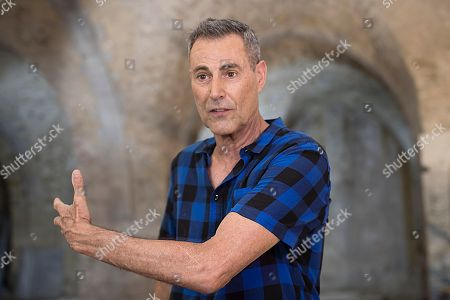 Uri Geller owner of Uri Geller Museum and an speaks at a 'Masbena' in Arabic or a soap manufacturing factory from olive oil dated to the 19th Century from the Ottoman Empire period, in the Old City of Jaffa, outskirts of the Israeli coastal city of Tel Aviv, 14 August 2018. According to the Israel Antiquities Authority Jaffa expert, this previously unknown factory, is the second of its kind to have been discovered in Jaffa. The site was well preserved and included troughs for mixing raw materials for the soap, a large cauldron, a hearth, water cisterns and underground vaults that were used for storage. The production of soap from olive oil was sold locally, while a large share was destined for export to regions within the Ottoman Empire, mainly for the Egyptian market.