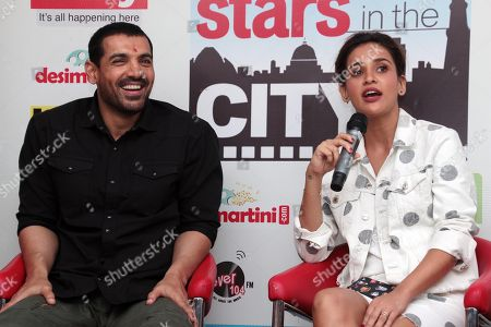 Stock Photo of John Abraham and Aisha Sharma