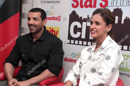 Stock Picture of John Abraham and Aisha Sharma