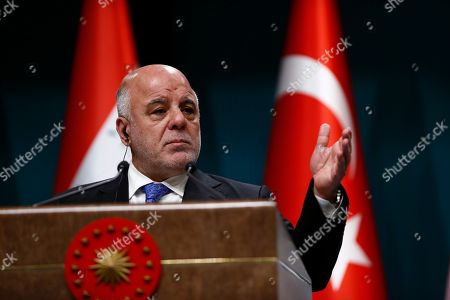 Iraq's Prime Minister Haider al-Abadi talks during a joint news conference with Turkey's President Recep Tayyip Erdogan, following their meeting at the Presidential Palace in Ankara, Turkey