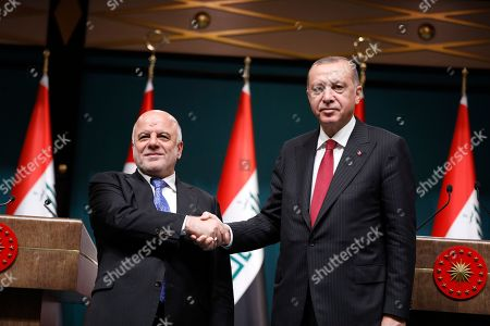 Haider al-Abadi, Recep Tayyip Erdogan. Iraq's Prime Minister Haider al-Abadi, left, shakes hands with Turkey's President Recep Tayyip Erdogan, following a joint news conference after their meeting at the Presidential Palace in Ankara, Turkey