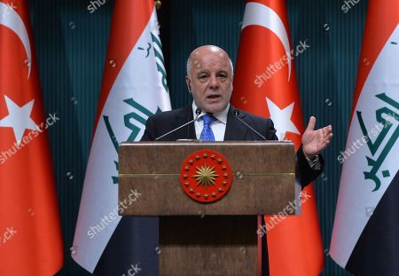 Turkish President Recep Tayyip Erdogan (Not Seen) and Iraqi Prime Minister Haider al-Abadi attend a press conference in Ankara, Turkey, 14 August 2018.
