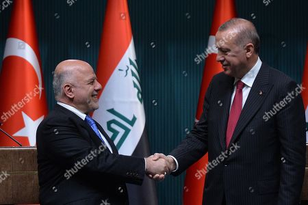 Stock Picture of Turkish President Recep Tayyip Erdogan (R) and Iraqi Prime Minister Haider al-Abadi (L) attend a press conference in Ankara, Turkey, 14 August 2018.