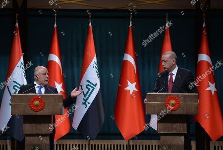 Turkish President Recep Tayyip Erdogan (R) and Iraqi Prime Minister Haider al-Abadi (L) attend a press conference in Ankara, Turkey, 14 August 2018.