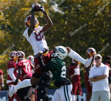 Dan Williams, Marcus Maye. Washington Redskins wide receiver Dan Williams (88) grabs a pass over New York Jets defensive back Marcus Maye (26) during the New York Jets Washington Redskins NFL football training camp in Richmond, Va