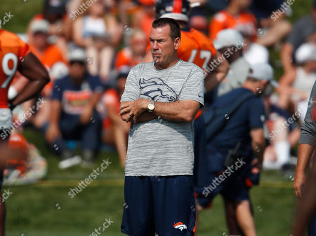 Gary Kubiak, gary kubiak. Denver Broncos senior personnel advisor Gary Kubiak looks on as players take part in drills during an NFL football training camp at the team's headquarters, in Englewood, Colo