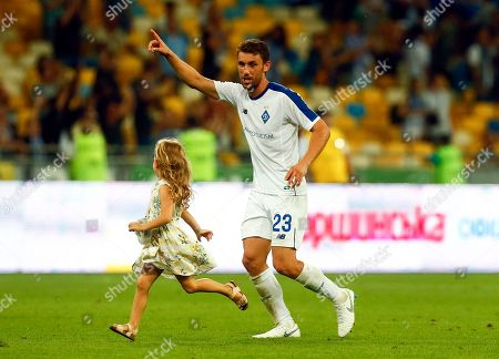 Dynamo Kiev's Josip Pivaric and his daughter celebrate after winning during the second leg third qualifying round Champions League soccer match between Dynamo Kiev and Slavia Prague at the Olympiyskiy stadium in Kiev, Ukraine