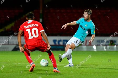 Scott Laird (3) of Forest Green Rovers passes the ball during the Carabao Cup match between Swindon Town and Forest Green Rovers at the County Ground, Swindon