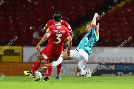 Scott Laird (3) of Forest Green Rovers tackles Michael Doughty (3) of Swindon Town during the Carabao Cup match between Swindon Town and Forest Green Rovers at the County Ground, Swindon