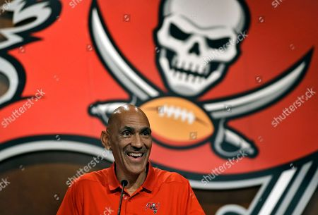 Former Tampa Bay Buccaneers head coach Tony Dungy laughs during a Buccaneers NFL football Ring of Honor news conference, in Tampa, Fla. Dungy will be inducted during halftime of the Bucs game against the Pittsburgh Steelers on Sept. 24th