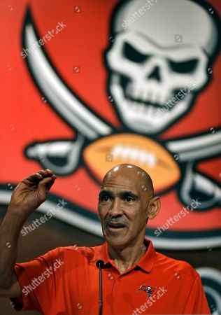 Former Tampa Bay Buccaneers head coach Tony Dungy gestures during a Buccaneers NFL football Ring of Honor news conference, in Tampa, Fla. Dungy will be inducted during halftime of the Bucs game against the Pittsburgh Steelers on Sept. 24th