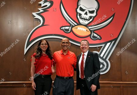 Former Tampa Bay Buccaneers head coach Tony Dungy, center, poses for a photo with Darcie Glazer Kassewitz, owner/president of the Tampa Bay Buccaneers foundation and team owner/co-chairman Bryan Glazer during a Buccaneers NFL football Ring of Honor news conference, in Tampa, Fla. Dungy will be inducted during halftime of the Bucs game against the Pittsburgh Steelers on Sept. 24th
