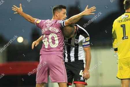 Ian Henderson and John Welsh  during the Carabao Cup match between Grimsby Town FC and Rochdale at Blundell Park, Grimsby