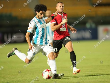 Stock Picture of Tala'ea El Gaish player Kareem Tarek (R) in action against  Pyramids player Omar Gaber (L) during the Egyptian league soccer match between Tala'ea El Gaish and Pyramids in Cairo, Egypt, 14 August 2018.