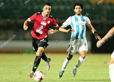 Tala'ea El Gaish player Moustafa Mohamed (L) in action against Pyramids player Omar Gaber (R) during the Egyptian League soccer match between Tala'ea El Gaish and Pyramids in Cairo, Egypt, 14 August 2018.