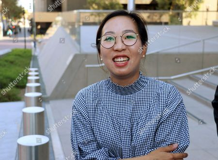 Yea Ji Sea, a former U.S. Army specialist who was born in South Korea, talks with reporters after a federal court hearing in Los Angeles . Sea filed a lawsuit in July, 2018, demanding a response to her citizenship application after the military moved to discharge her. She has since been discharged. U.S. District Judge Michael Fitzgerald says the government will have to rule on Sea's application by Sept. 5 or explain the delay to the court