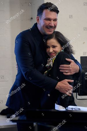 Brazilian singer Paulo Szot (L) and Australian singer Tina Arena (R) embrace after performing during a rehearsal for the Opera Australia musical production of Andrew Lloyd Webber's Evita, in Sydney, Australia, 15 August 2018. Evita will play at the Sydney Opera House from 13 September, followed by a season at Arts Centre Melbourne from 05 December.